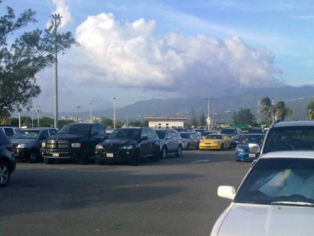 Kingston Airport Car Park with city Kingston and St Andrew Mountains in background