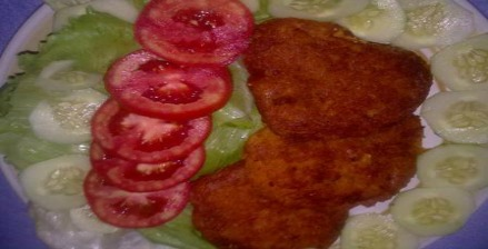 Salt fish fritters on salad plate