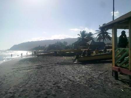 Beach view from Little Ochi Beach Restaurant Huts